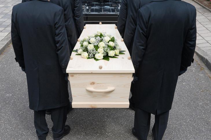 Bild von Sargträgern auf Beerdigung